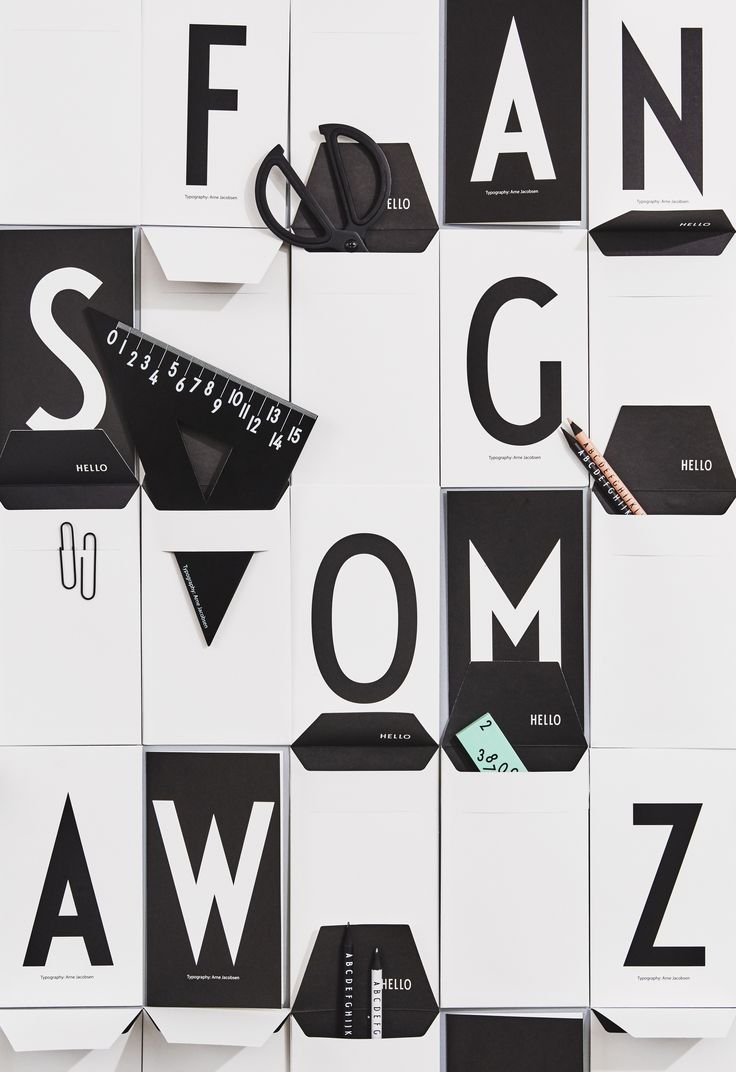 A storage wall made of personal greeting cards. P for pencils, R for ruler, and N for notes. Typography: AJ Vintage ABC.