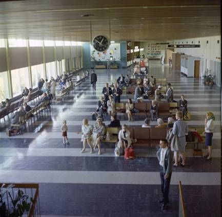 Interior of the old Perth Airport, with that wall of clocks (London, New York, Paris etc) on the back wall.