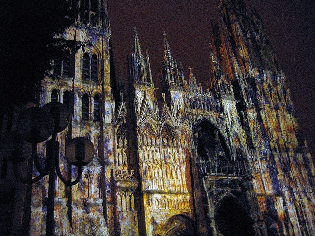 This is awesome! This photo is taken during the light show onto the Cathedral de Rouen during the month June of this year. They projected different famous Impressionist paintings as well as modern Impressionistic paintings of Claude Monet onto the Cathedral itself.