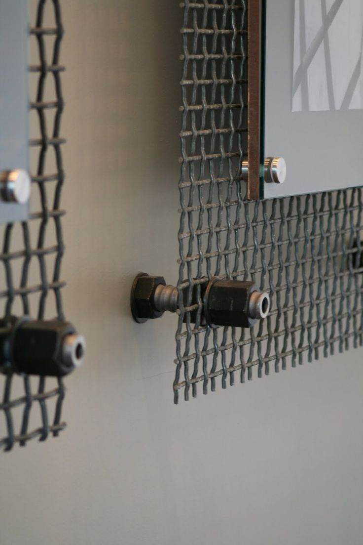 Autumn mounted a client's art work to this metal screen - love the industrial look and it makes the art stand out!