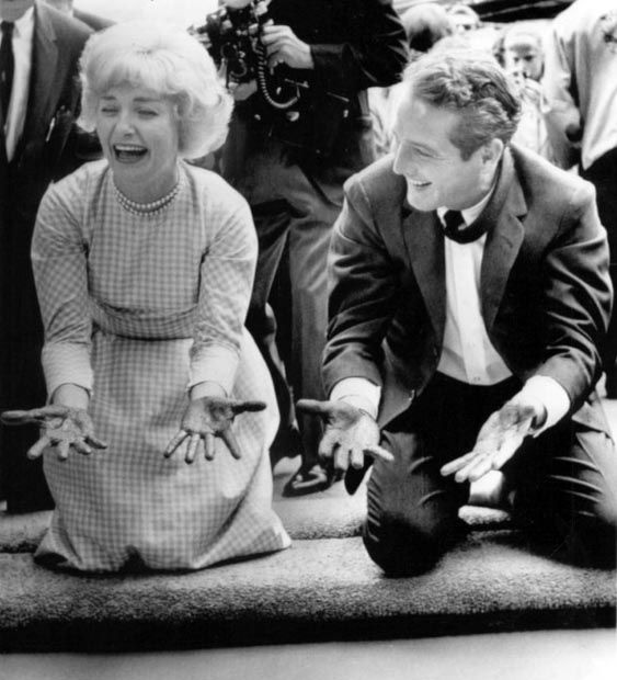 Joanne Woodward and Paul Newman get a kick out of the handprint ceremony. May, 1963