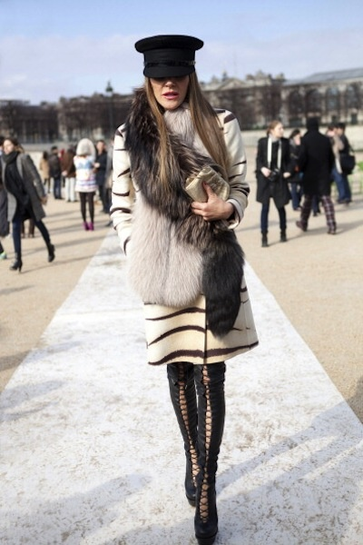 The 25 Best Street Style Snaps from Paris Fashion Week: Rocking thigh high boots, a fur stole, and an always-covetable Louis Vuitton captain's hat - all in a day's work for Anna Dello Russo.
