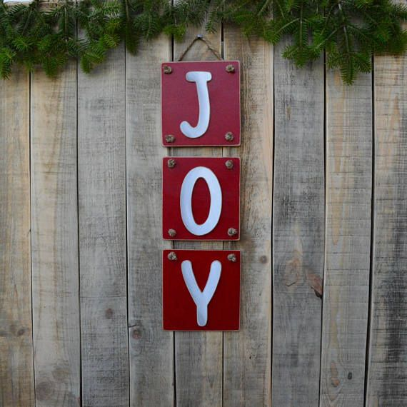 JOY christmas rustic sign in a unique design.  An entirely handmade wooden christmas sign is here to complete your Christmas decoration. You can hange it in your living room or your bedroom or you can give it as a gift to a friend or a family member.  If you want this year to decorate your home with something unique, thats your chance. This handmade wooden sign is an OOAK product that you wont find anywhere else. ❂ P R O D U C T I O N P R O C E S S ❂  The thing that makes these wooden signs…