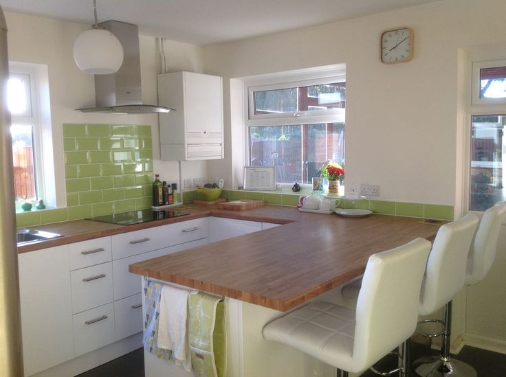 Finished kitchen! Wickes Houston with colmar oak work tops. Ikea lighting. Bar stools from Atlantic Shopping. Lime green metro tiles from Topps. Dulux Jasmine white walls.