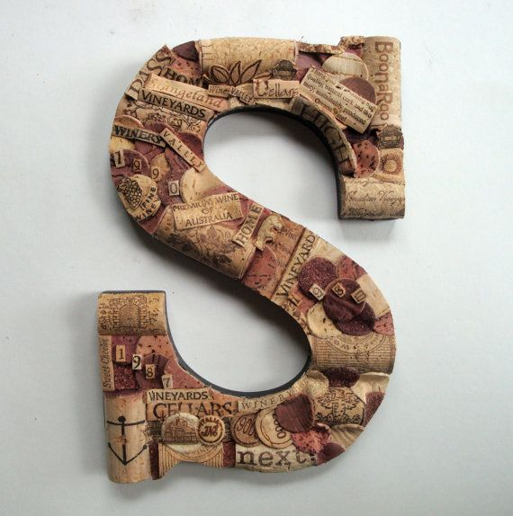 If I were going to muster up a cork monogram letter, it would have to be a funky little number like this monogram made from bits and bobs of corks available on Etsy from Creative Corks N More. There is actually some serious detail in this if you stop and look closer.