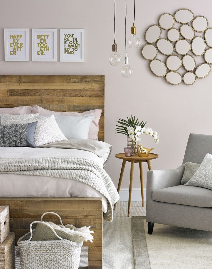 Mix soft pink and rustic textures with touches of metal for a cosy but chic bedroom.