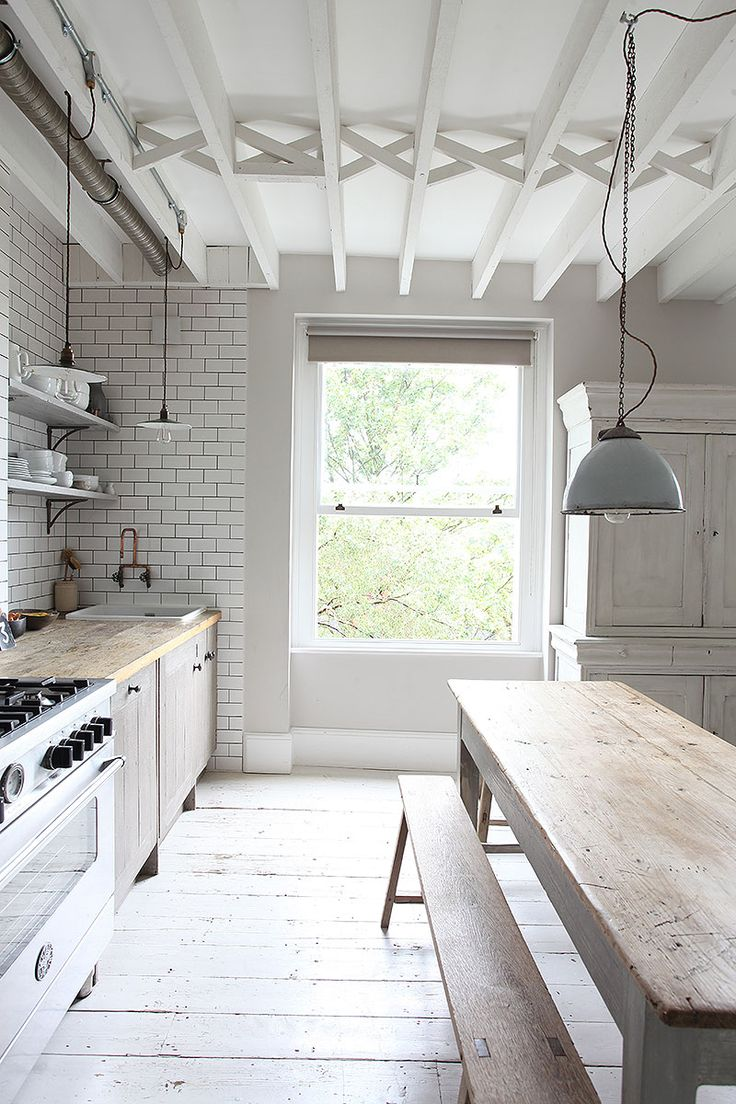 Kitchen built around the chimney breast. In a flat in Primrose Hill, London