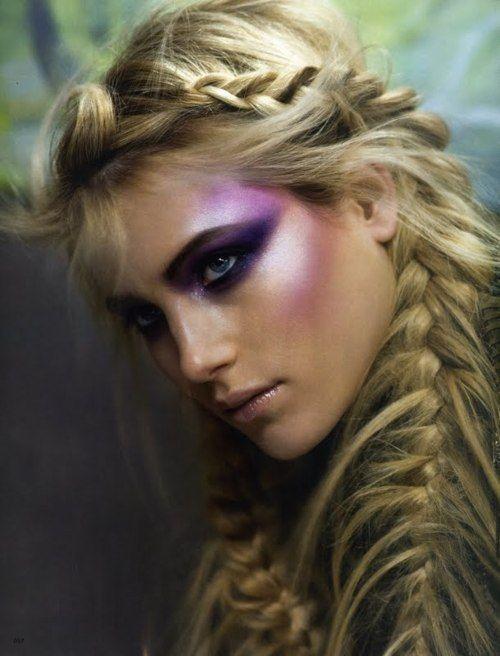 deep purple smokey eye radiates to lilac temples and cheek highlights