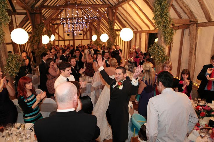 toasting the happy couple in this beautiful Kent barn