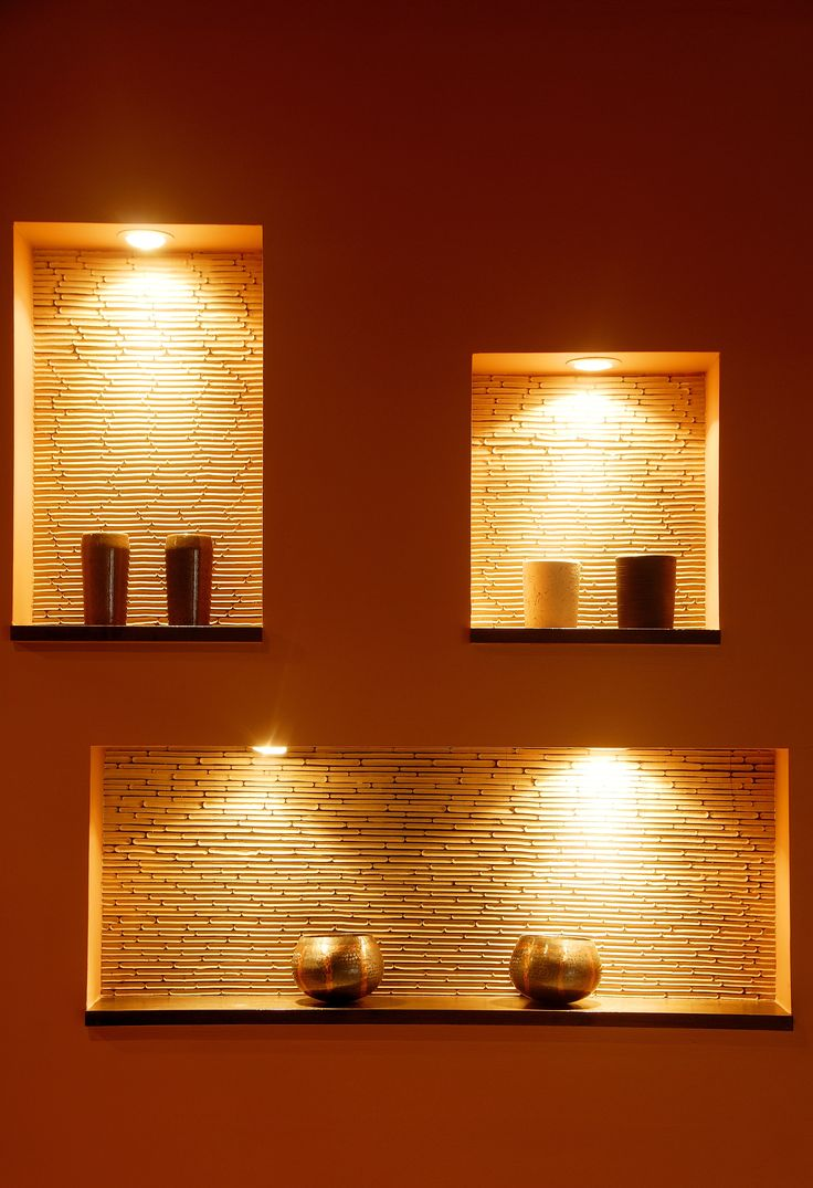 Contemporary lighting against a dramatic red painted wall - Modern wall niche designs ...