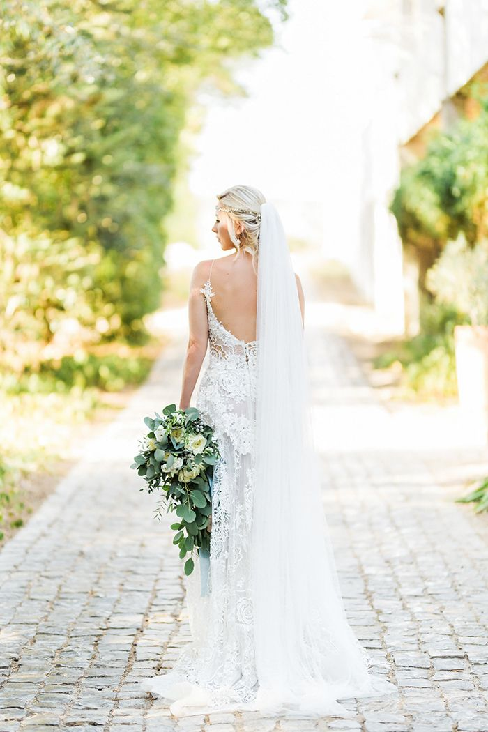 Bohemian Glam Bridal Gown with an Open Back  https://heyweddinglady.com/mediterranean-citrus-inspired-destination-wedding/    #wedding #weddings #weddinginspiration #destinationwedding #realwedding #bohemianwedding #brides #realbride #weddingdress #veil