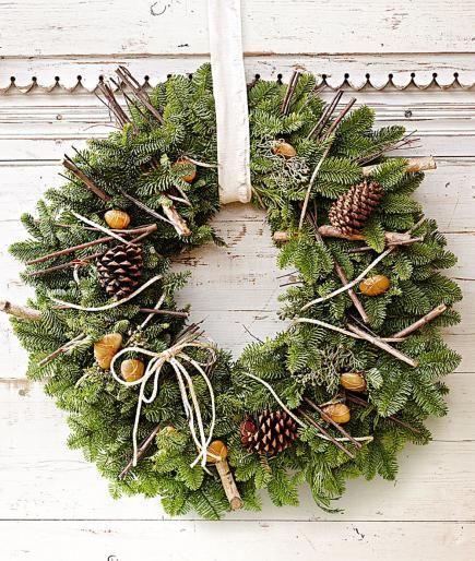 Copper wire adds a bit of sparkle to an otherwise earthy wreath. More holiday wreaths: http://www.midwestliving.com/homes/seasonal-decorating/beautiful-holiday-wreaths/?page=17,0