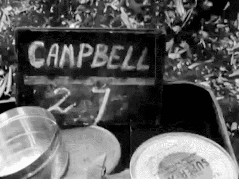 Jimmy Campbell's slate while filming in Sicily 1943. Cans of Kodak Super XX on the bottom of the frame.