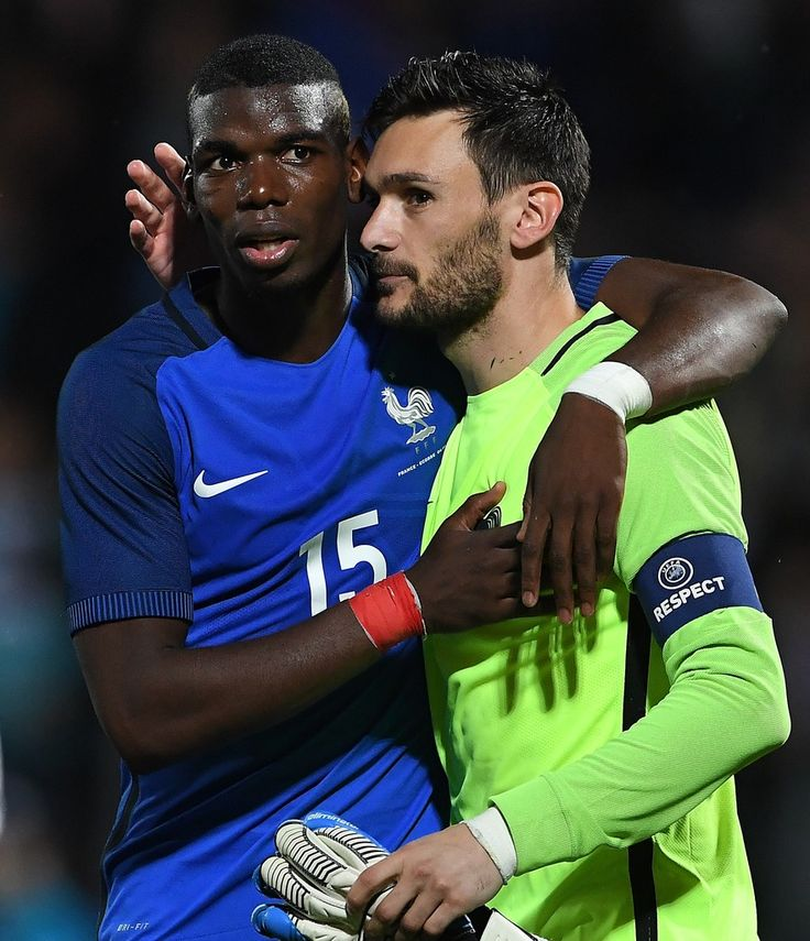 France's midfielder Paul Pogba and France's goalkeeper Hugo Lloris (R) celebrate during the friendly football match between France and Scotland, at the St Symphorien Stadium in Longeville-lès-Metz, Eastern France, on June 4, 2016.  / AFP / FRANCK FIFE