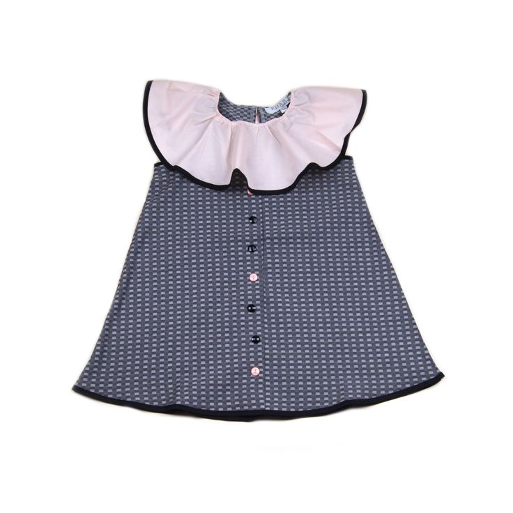 Knast grey houndstooth pattern dress with black cotton bias binding trim, pink clown ruffle neck with black and pink bevelled edge buttons down centre front. 100% cotton. Made in Turkey. $69.95 http://www.danskkids.com.au/collections/spring-summer-2015/products/knast-isa-dress-grey