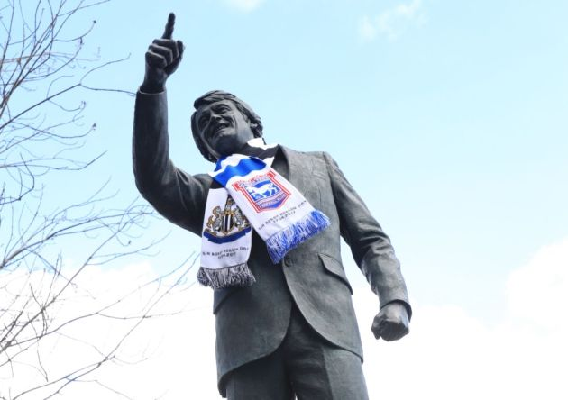 The statue of Sir Bobby Robson is decorated with a half-and-half scarf as his two footballing loves - Ipswich Town and Newcastle United - played each other at Portman Road.  Photo: Adam Davy