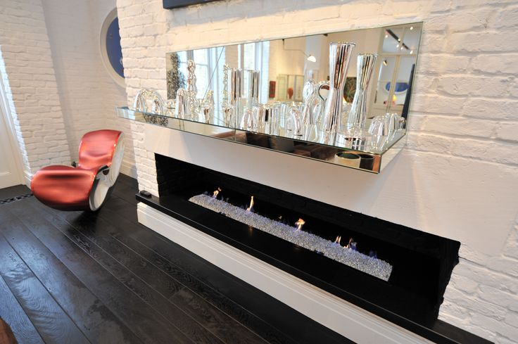Honed Zimbabwe black #granite is used for this striking #fireplace