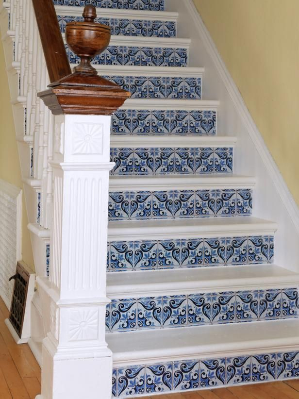 A staircase in an 1880s New England home was given a complete facelift using paint and wallpaper that looks like Mexican tile.
