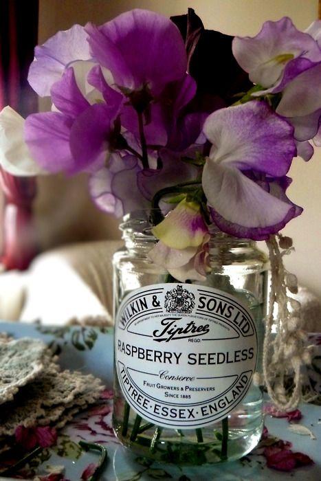 flowers in old jelly jar