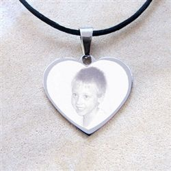 A beautiful and durable heart shaped pendant in solid Stainless Steel.  Custom engraved with any photo you'd like - a partner, a child, a pet ... any image can be engraved to make this very special personalised piece of jewellery.