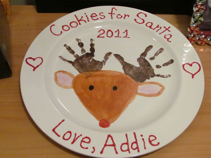Ceramic plate painted for christmas used my daughter 39 s for Handprint ceramic plate ideas