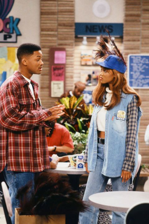 Tyra Banks 1993 high waisted jeans cropped,  white turtle neck, sleeveles denim shirt and tartan shirt + cap.