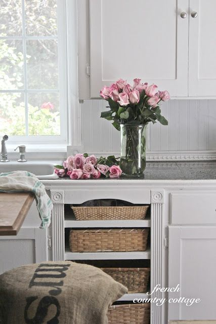 There were four drawers on each side of the sink that were removed. One of the spots became a place for the dishwasher and the other  - decided to turn into shelves  for baskets  by taking wood and lining the drawer supports to create shelves.