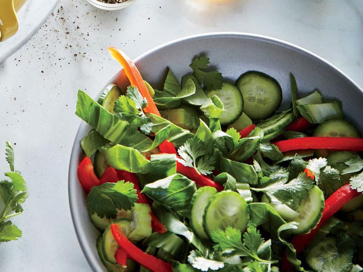 Thinly slice the bok choy stalks and leaves for a salad that's full of color and texture. You can also use larger bok choy, but save the...