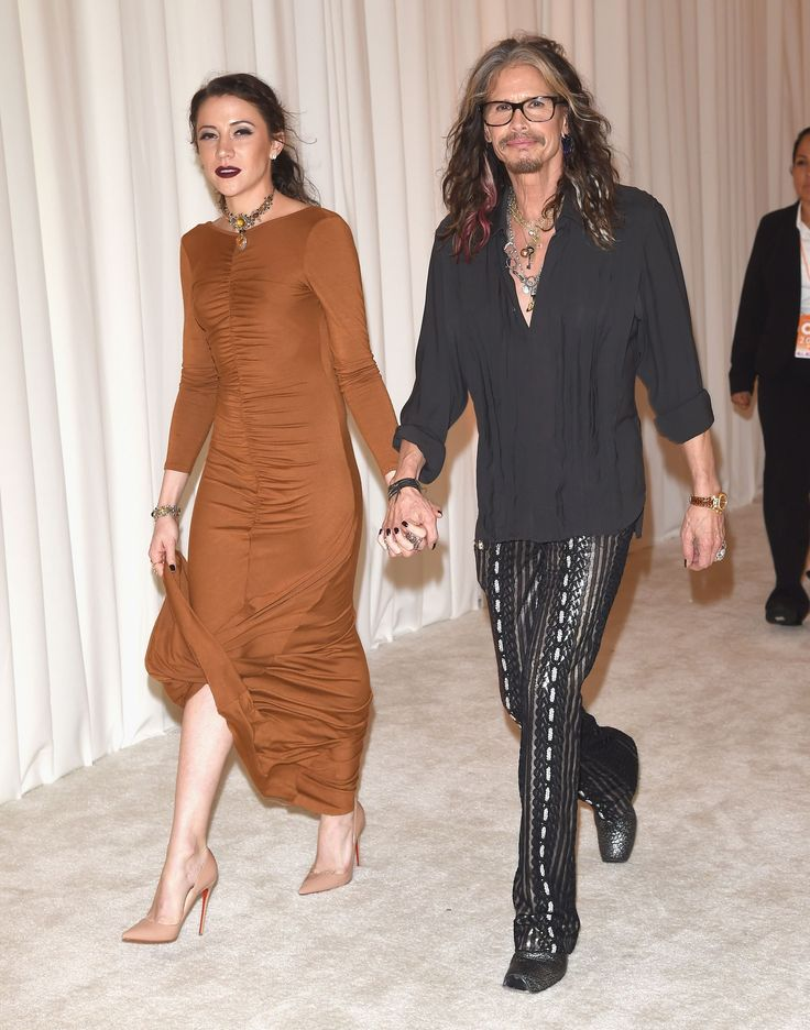 Aerosmith rocker Steven Tyler, 67, has moved in with his much younger personal assistant, Aimee Ann Preston, 28, in LA and Nashville, Tenn., where he's been working on his solo country album.