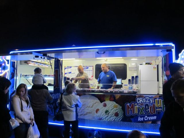 Business is booming - the Crazy mixed Up icecream trailer fully lit at night drew the people in #neon #led #icecream