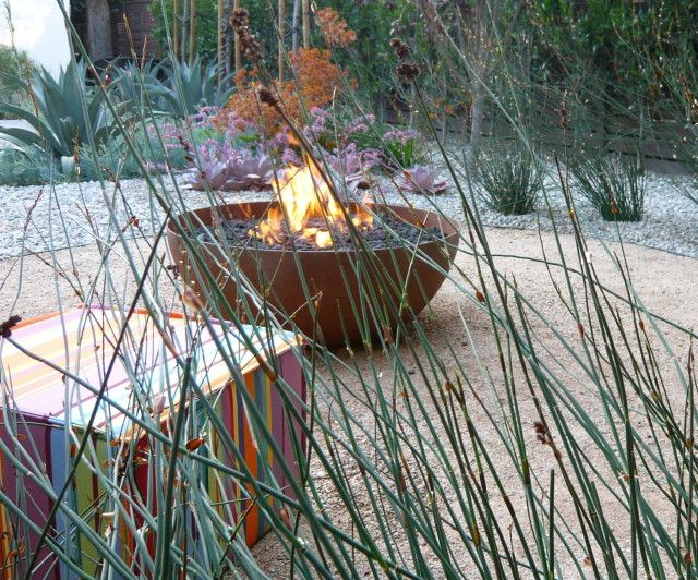 Circular decomposed granite fire pit area surrounded by for Gravel fire pit area