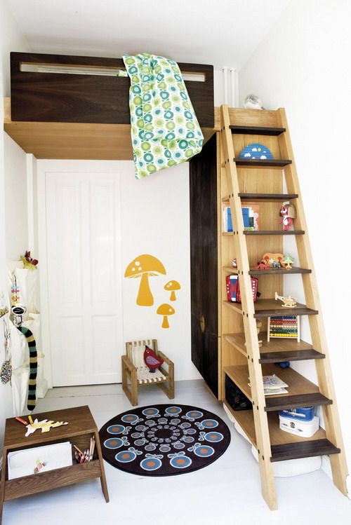 Clever solution for a small room. I have a small bedroom without a closet, I imagine we could frame in a little closet behind the stairs as well!