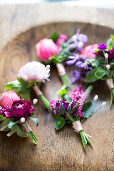 Pink and purple #boutonnieres   Photography: Jade And Matthew Take Pictures - jadeandmatthew.com