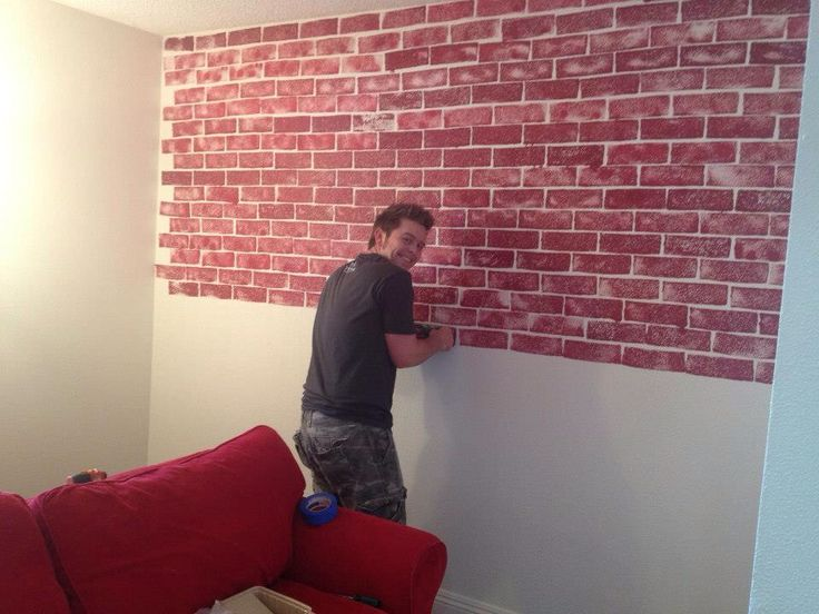 Cut a car sponge into the shape of brick and gently dip into red paint and gently against the wall to give it that brickwall look