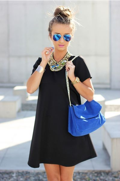 Blue purse, black dress, ray bans