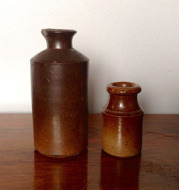 Two stoneware pots made in England.  The first larger pot with a pouring lip is 4.5 tall and has  Lovatt & Lovatt, Langley Mill, Notts. stamped on the side. These were manufactured between 1895-1930.  The second is a smaller ink pot which is 2.5 tall and is quite faded in places with a small chip to one side. ( see photo)  Both pots have rough glaze and minor marks and scratches consistent with age, which adds to their character and charm.  Please note: We are happy to post our vintage items…