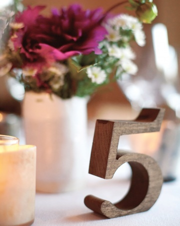 Table number. Wooden number...you could wrap them in yarn, decoupage them, or do other crafty stuff