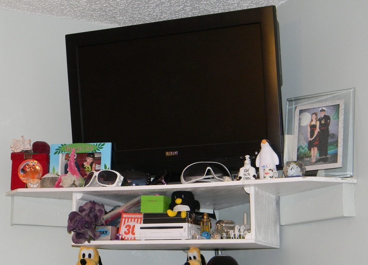 a corner wall shelf system for tv with storage underneath or a wii