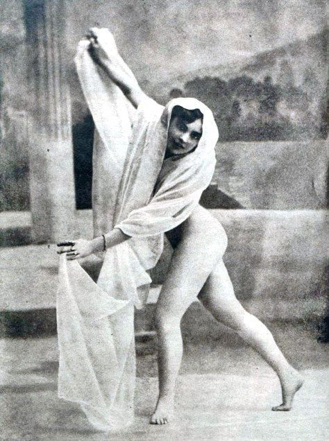 Mata Hari, nude, performing veiled dance with only one sheer veil left
