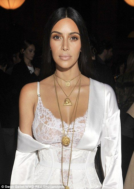 Kim Kardashian continues her lingerie parade at Paris Fashion Week as she hits the Givenchy SS17 show in sheer white negligee and a draped silk gown | Daily Mail Online