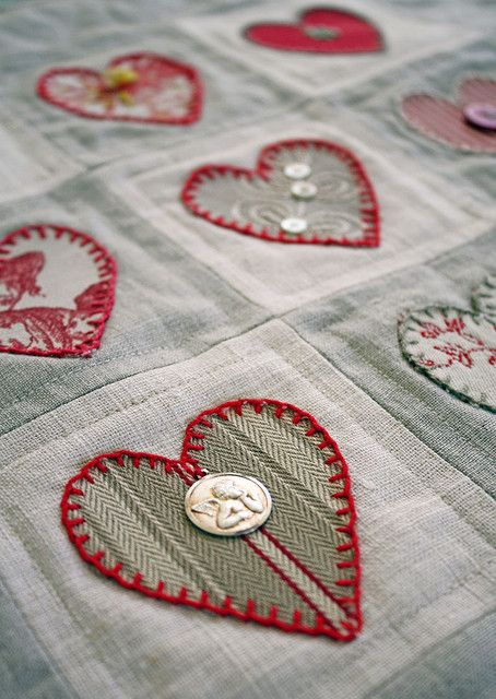 Heart Quilt. I like the blanket stitching around the hearts. And the fabrics. And the buttons. ;)