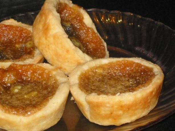 Melt in your mouth butter tarts, oh sooo good !!  The method for baking is unusual, but will prevent the filling from boiling over.
