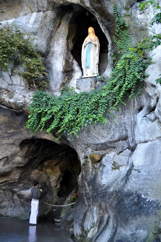 "Our Lady of Lourdes is a title of the Blessed Virgin Mary in honor of the Marian apparitions have taken place before various individuals on separate occasions around Lourdes, France. Most prominently among these is the apparition of February 11, 1858, when St. Bernadette Soubirous, a 14-year-old peasant girl admitted to her mother that a ""lady"" spoke to her in the cave of Massabielle, (a mile from the town) while gathering firewood with her sister and a friend."