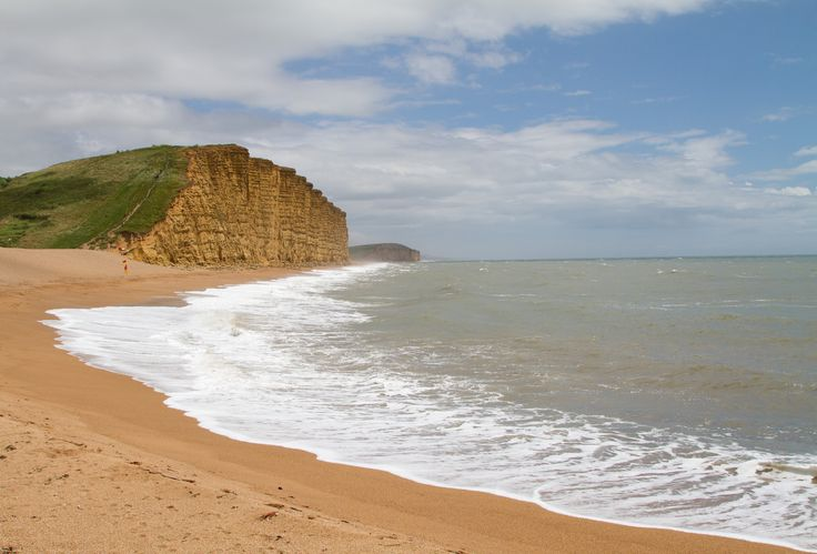 https://flic.kr/p/J6QyfJ | West Bay, Dorset (Jurassic Coast) | The beach and East Cliff at West Bay, Dorset on England's Jurassic Coast.  Fascinating geology with alternating horizontal bands of harder and softer rock strata which are frequently eroded causing large sections of cliff to collapse onto the beach.  From Wikipedia:- The cliffs to the east of the harbour are composed of Bridport Sand Formation and Inferior Oolite, while immediately to the west they are Frome Clay (Upper Fullers…