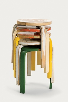 A stack of painted and worn Alvar Aalto Stool 60s, perhaps one of the most popular pieces from Artek's archive, given new life in the 2nd Cycle series by Tom Dixon. via Dwell