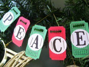 This super easy Merry Christmas garland is made out of blank red and green tickets. A fun Christmas craft to make with your kids!