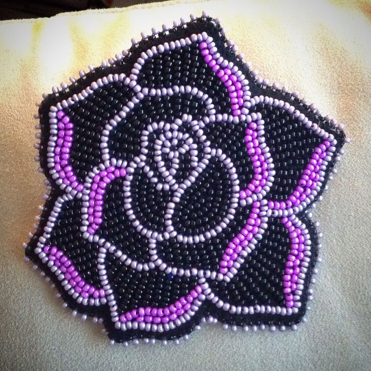 A hair barrette that I beaded for a co-worker for our Christmas gift exchange. A rose, outlined with a metallic lavender, some fuschia, and black beading!!!  Carmen Dennis (Tahltan)