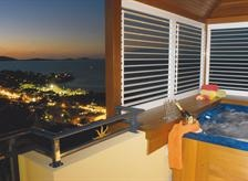 Outdoor Living Areas with Aluminum Shutters = Spa views.
