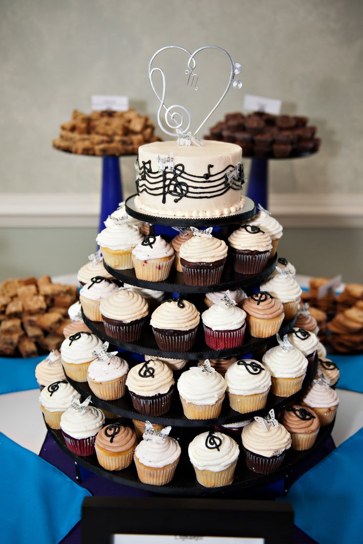 Close up of our delicious cupcakes by Shephardstown Sweet shop. Music and butterfly themed! We got the cake topper on Etsy! http://www.etsy.com/listing/159051980/cup-cake-display-musical-heart-treble?ref=shop_home_active Photo by http://alifestudio.com/