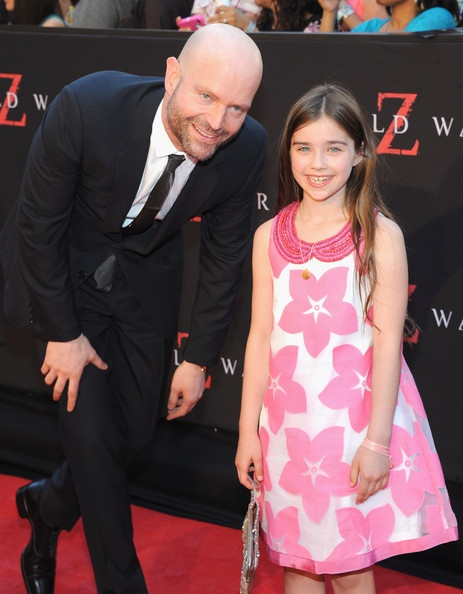 """Director Marc Forster (L) and Actress Sterling Jerins attend the """"World War Z"""" New York Premiere at Duffy Square in Times Square on June 17, 2013 in New York City."""
